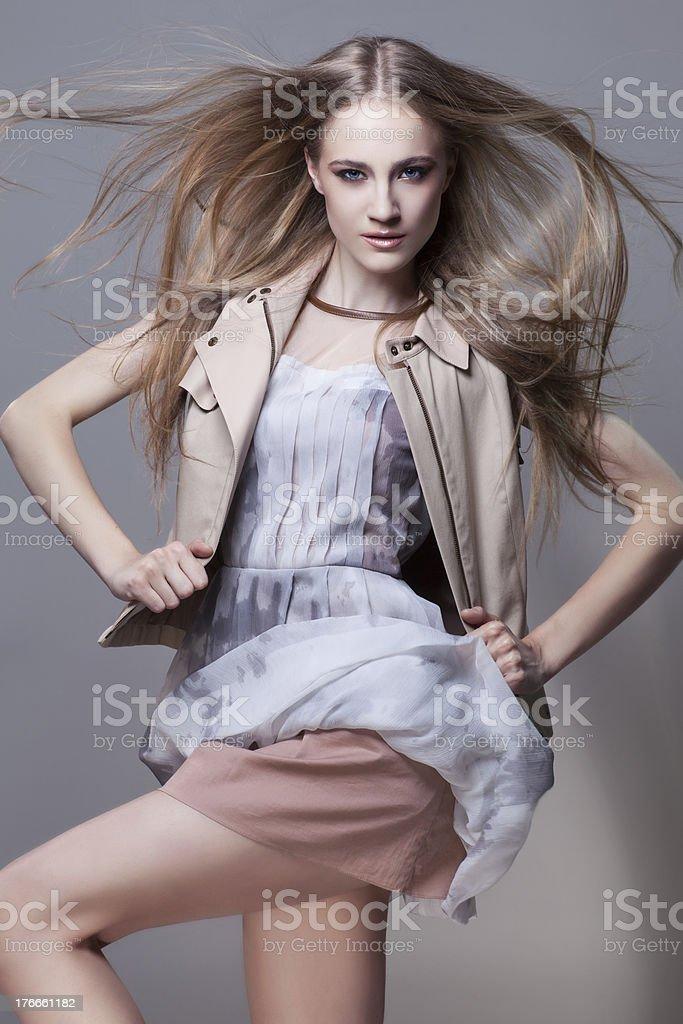 Girl in short dress and waistcoat royalty-free stock photo
