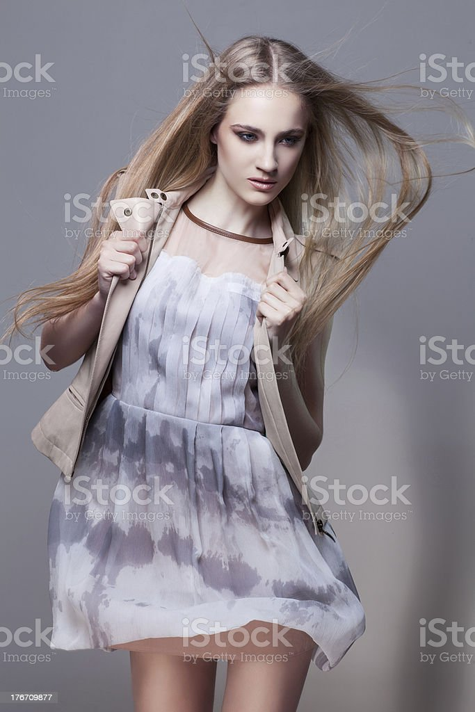 Girl in short dress and waistcoat royalty-free stock photo