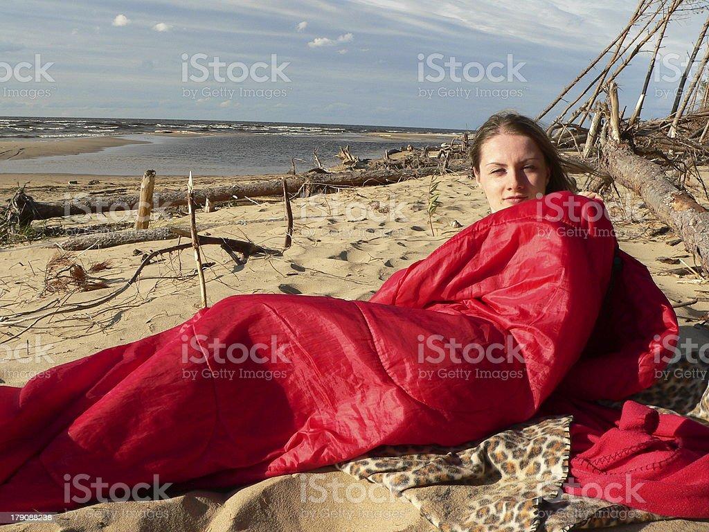 Girl in sleepingbag stock photo