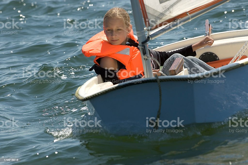 Girl in small sailing boat royalty-free stock photo