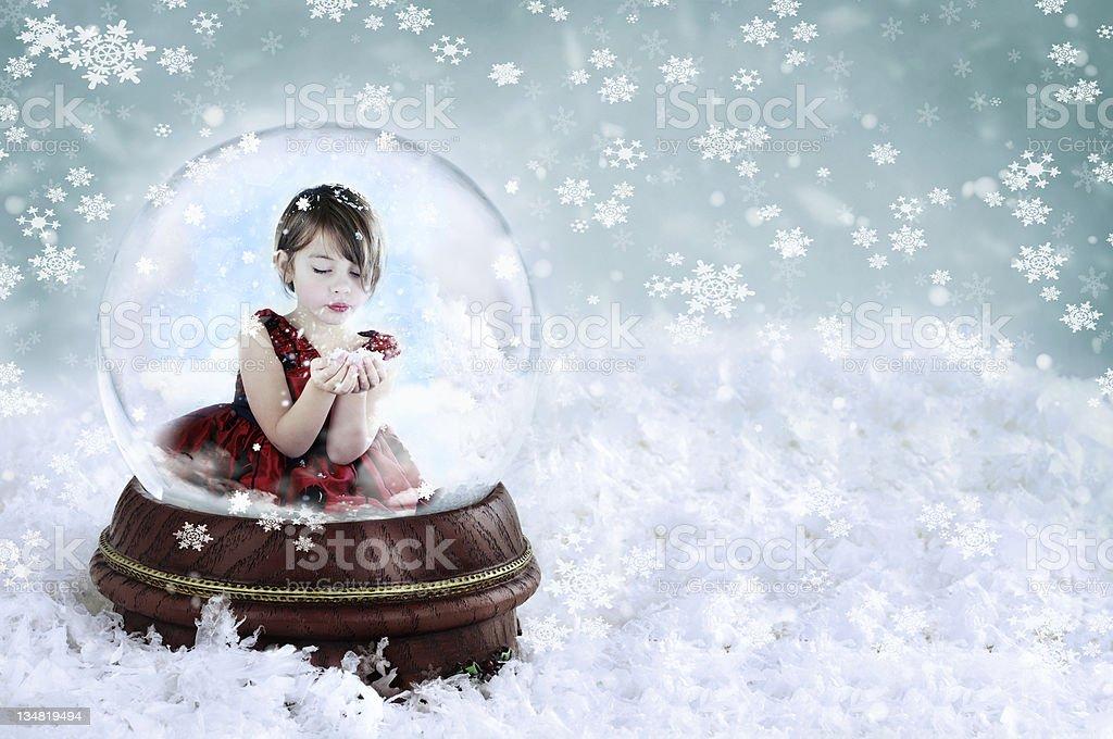 Girl in Snow Globe stock photo