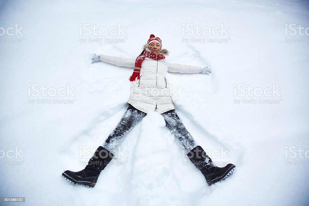 Girl in snowdrift stock photo