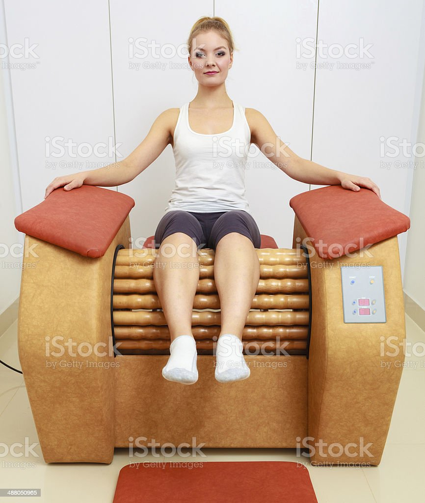Girl in sportwear on relax massage equipment healthy spa salon royalty-free stock photo