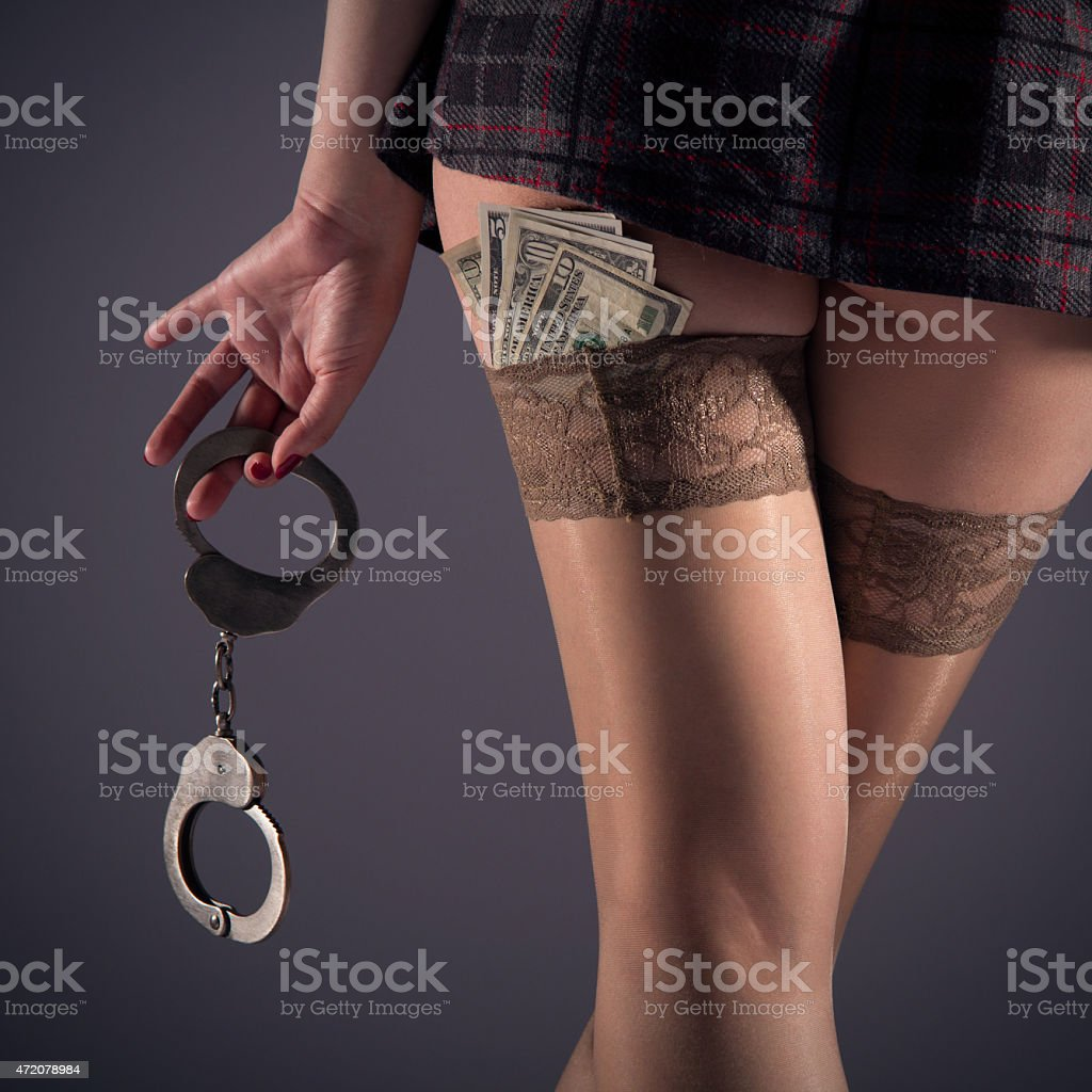 Girl in stockings with handcuffs stock photo
