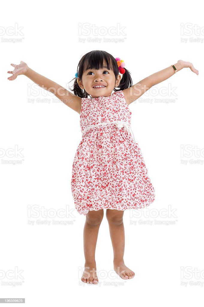 girl in studio with arms outstretched stock photo
