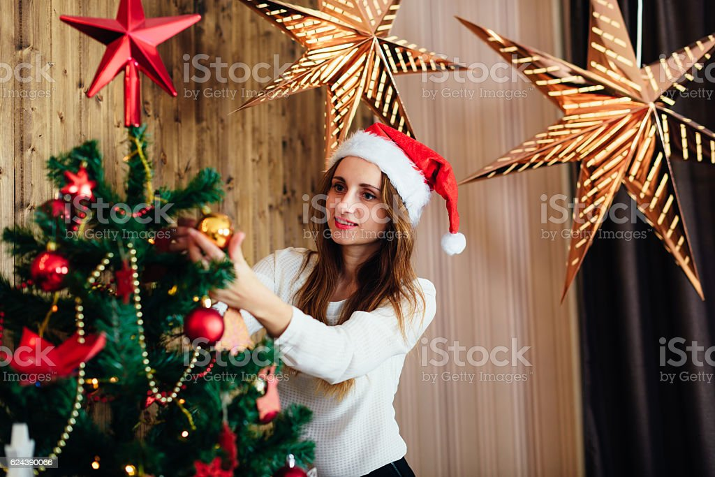 girl in studio with New Year's interior stock photo