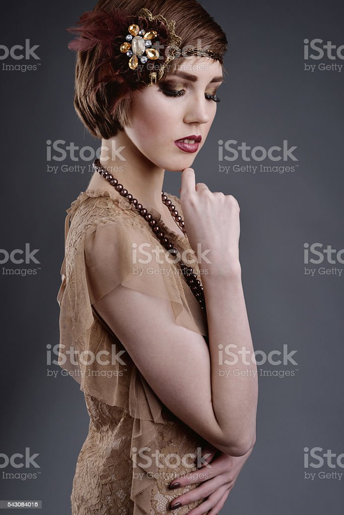 girl in style 20 with short hair in elite old-style stock photo
