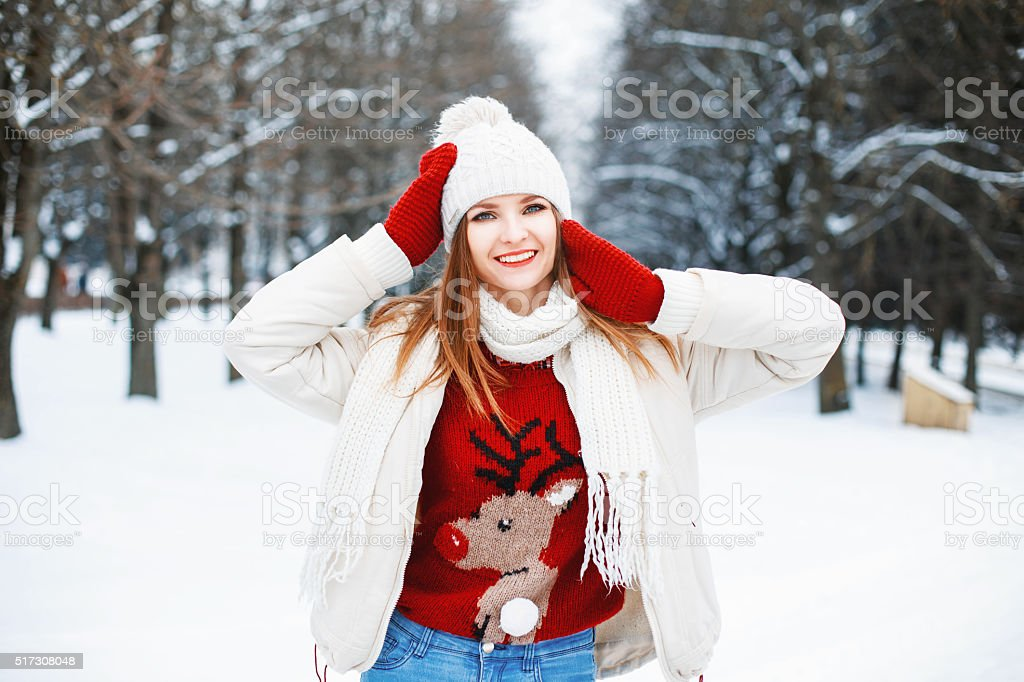 Girl in stylish winter clothes resting in a park stock photo