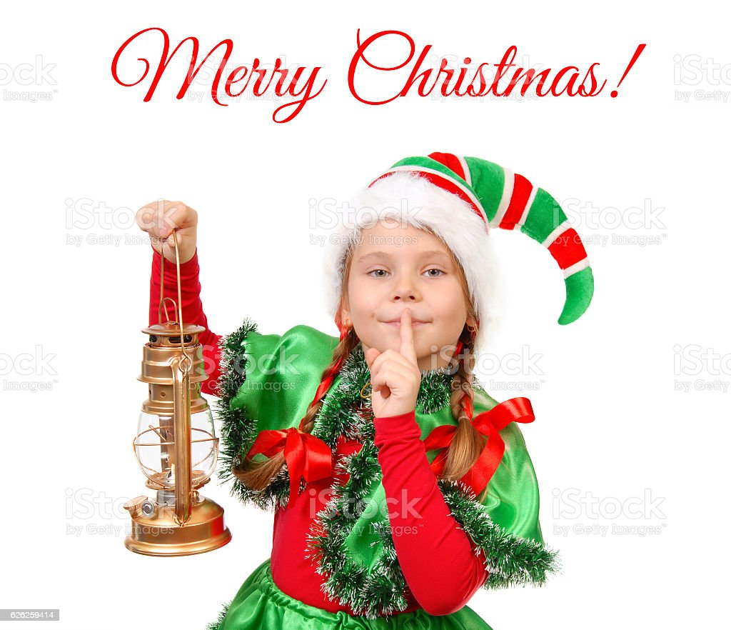 Girl in suit of Christmas elf with oil lamp stock photo