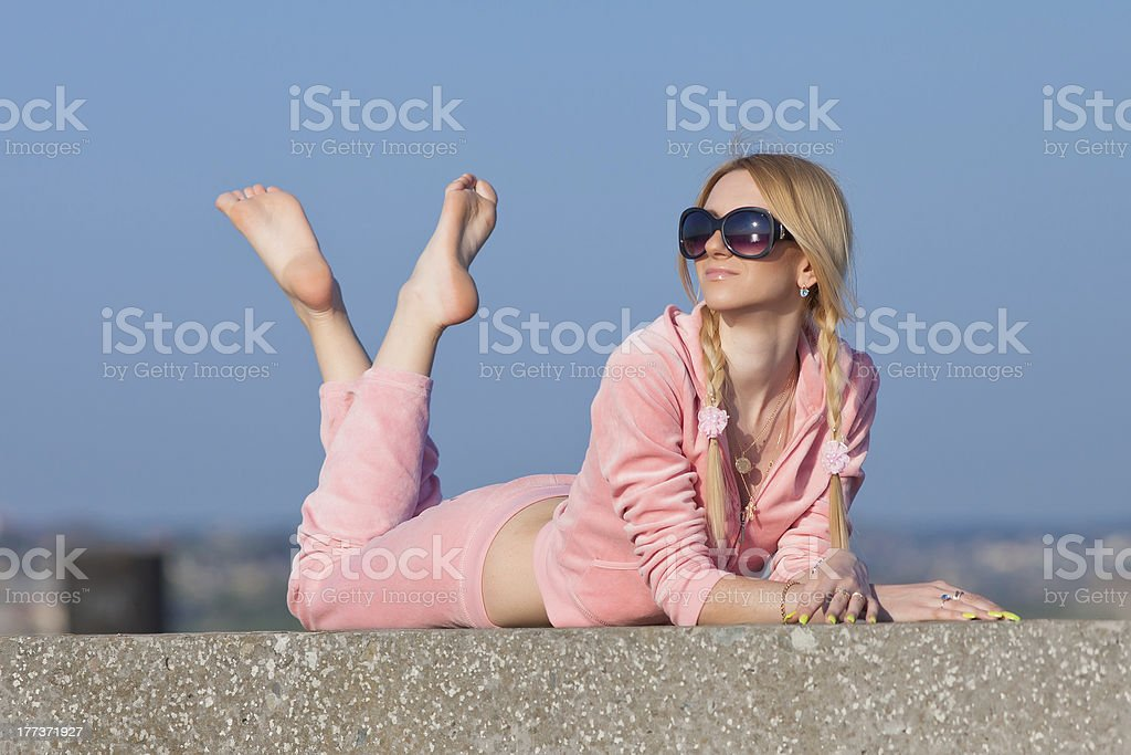 Girl in sunglasses resting on open air royalty-free stock photo