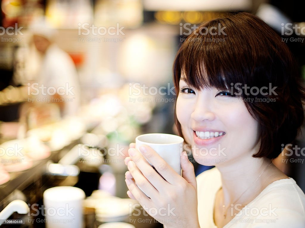 Girl in sushi restaurant royalty-free stock photo