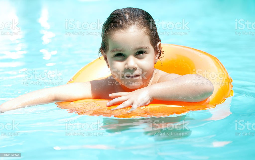 Girl in swimming pool royalty-free stock photo