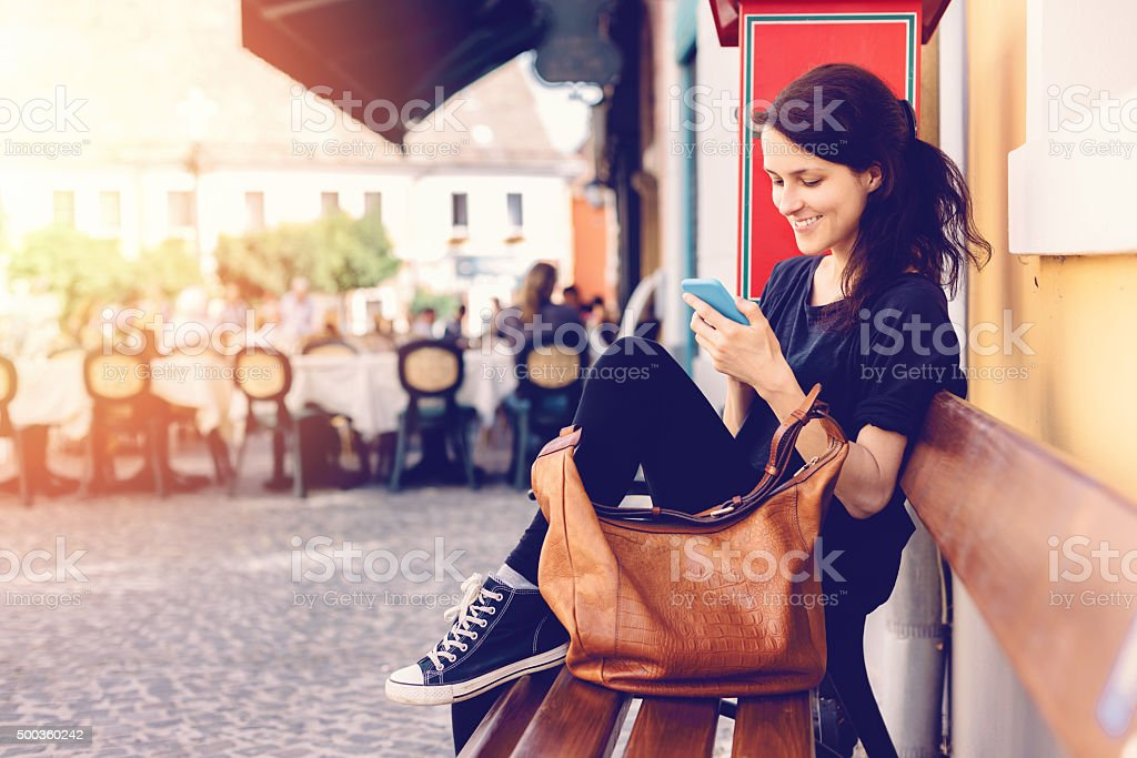 Girl in Szentendre text messaging on the phone stock photo