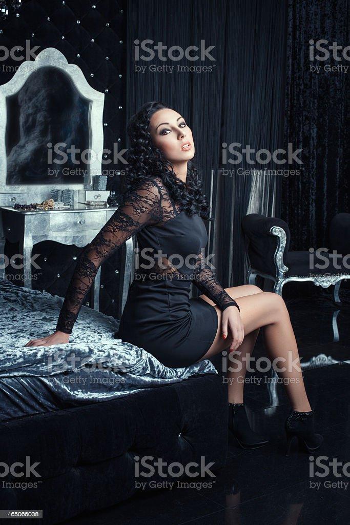 Girl in the bedroom flirting. stock photo