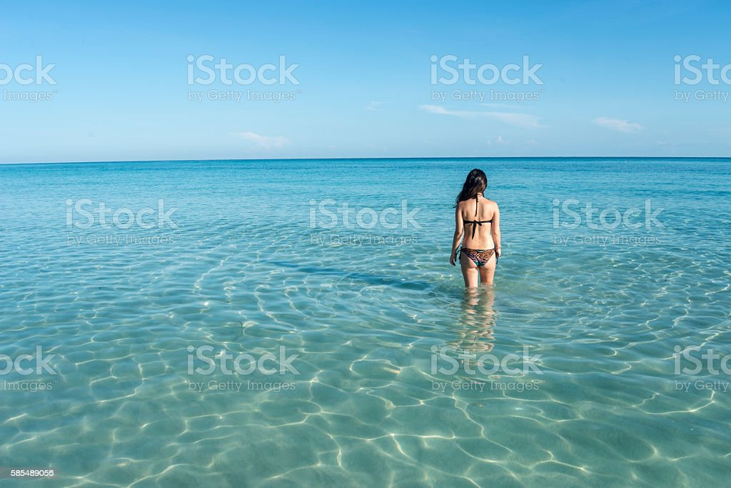 girl in the blue waters of the Caribbean stock photo