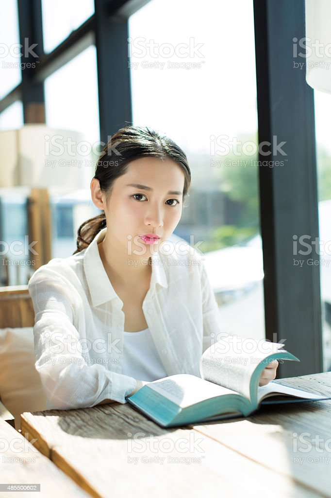girl in the  bookstore  reading stock photo