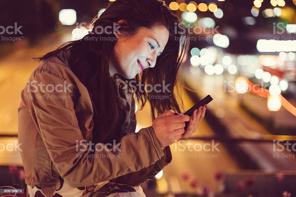 Girl in the city by night stock photo