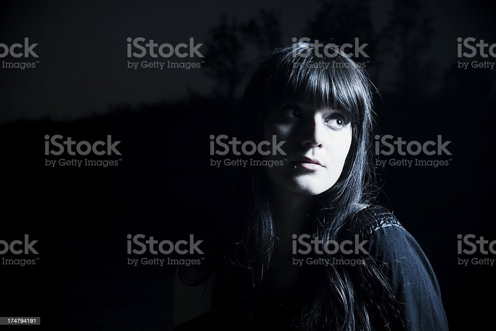 Girl in the dark stock photo