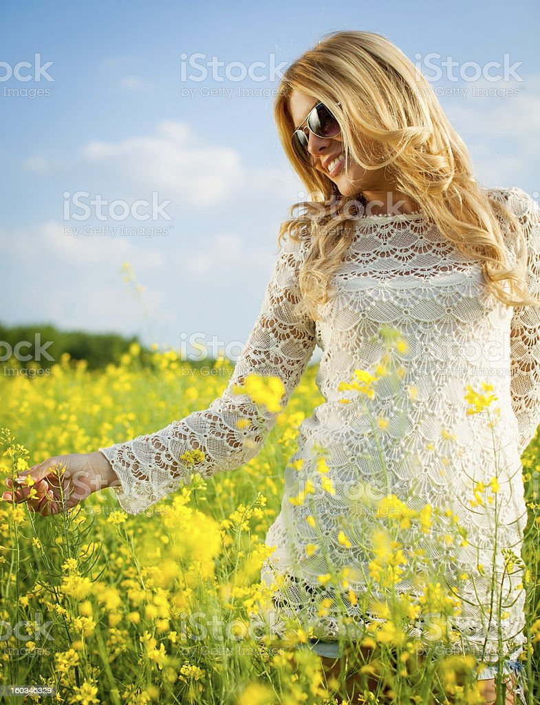 Girl in the flowers royalty-free stock photo