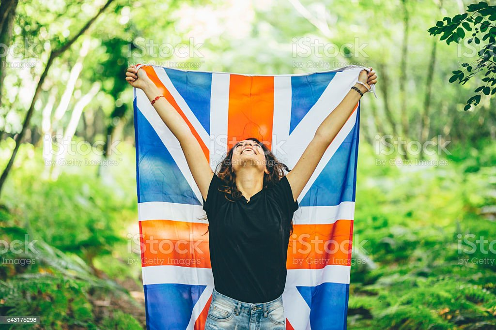 Girl in the forest with an English Flag stock photo