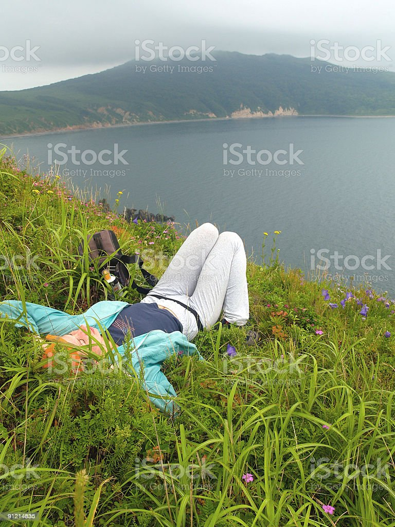 girl in the grass against sea landscape royalty-free stock photo