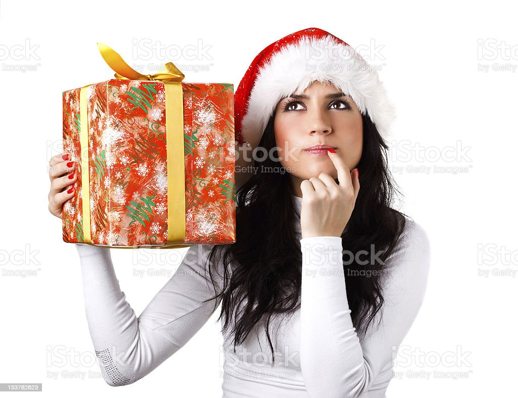 girl in the hat of Santa Claus with a gift royalty-free stock photo