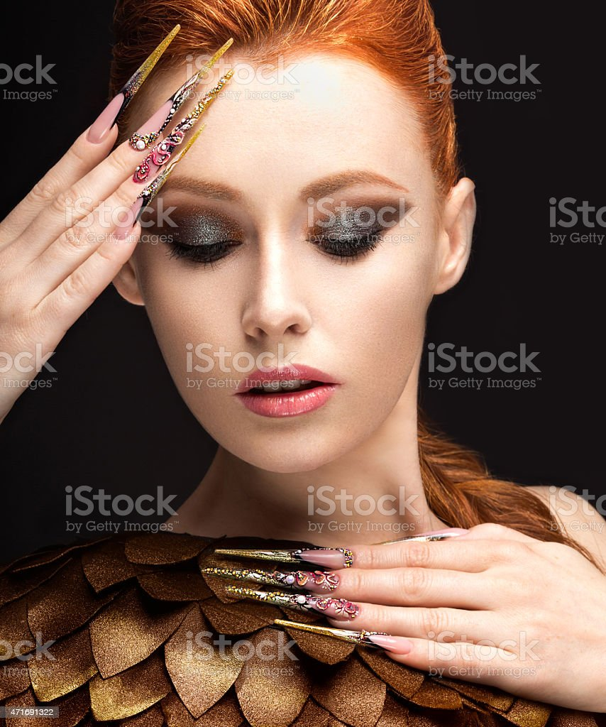 girl in the image of the Phoenix with bright makeup stock photo