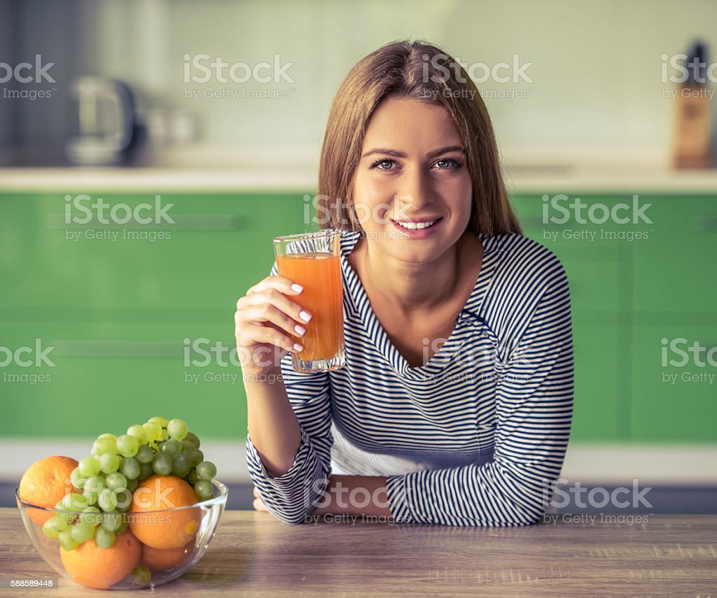 Girl in the kitchen stock photo