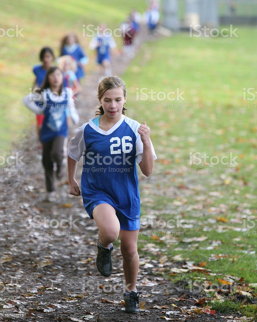 Girl in the Lead at Cross Country Race royalty-free stock photo