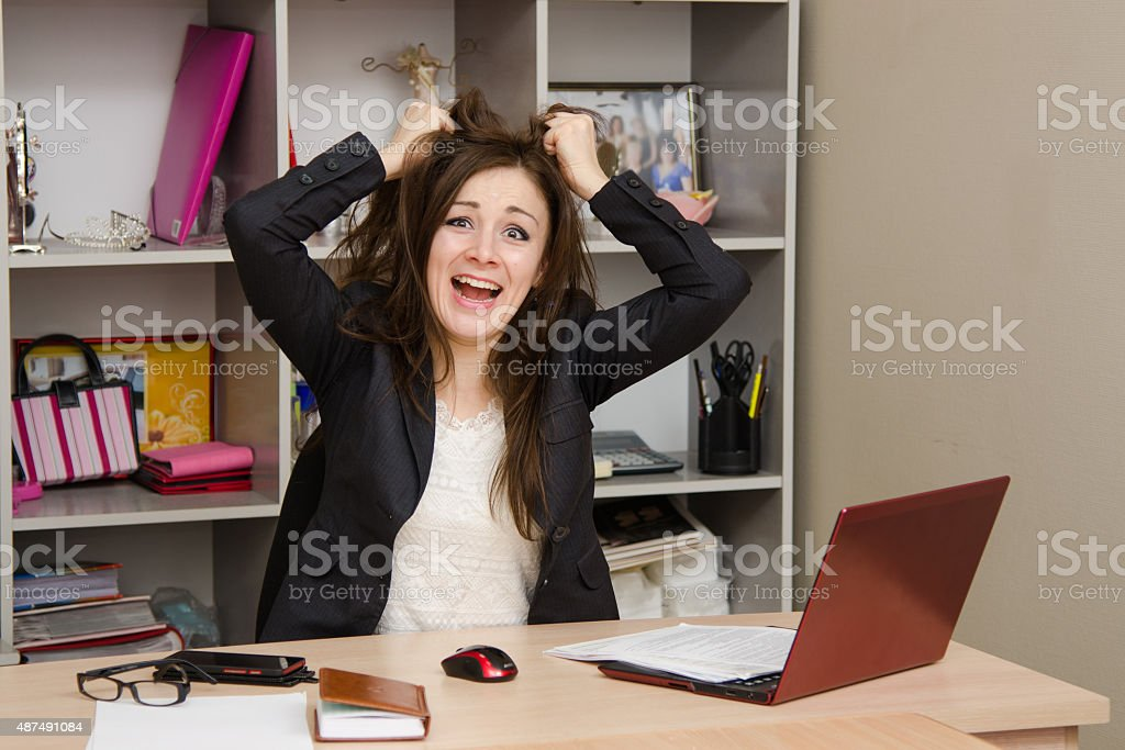Girl in the office tearing my hair out stock photo