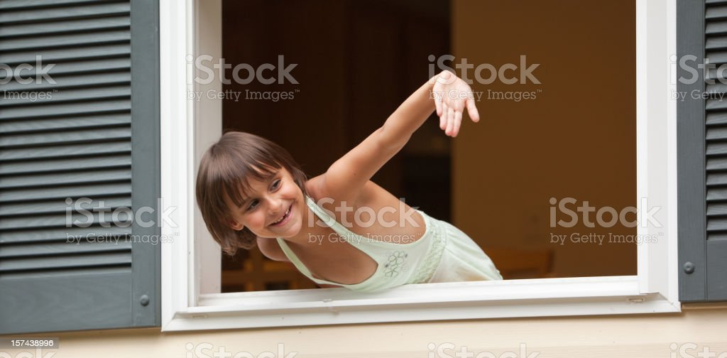 Girl in the open window say WELCOME royalty-free stock photo