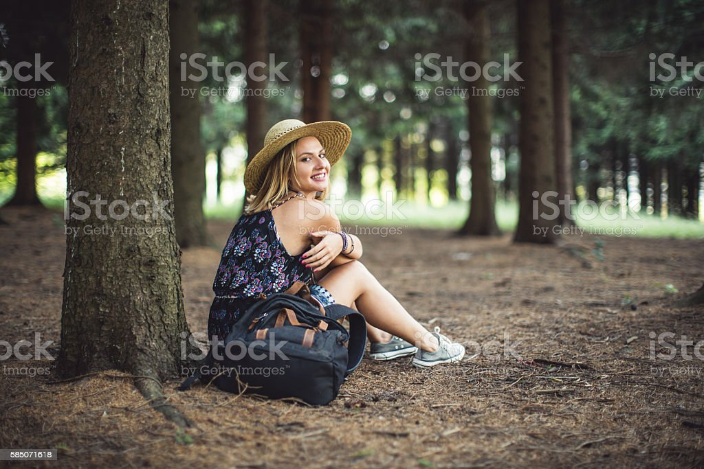 Girl in the pine tree forest stock photo