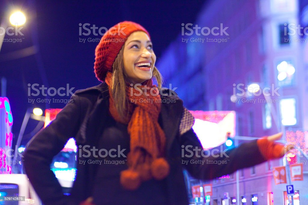Girl in the street checking if its raining stock photo