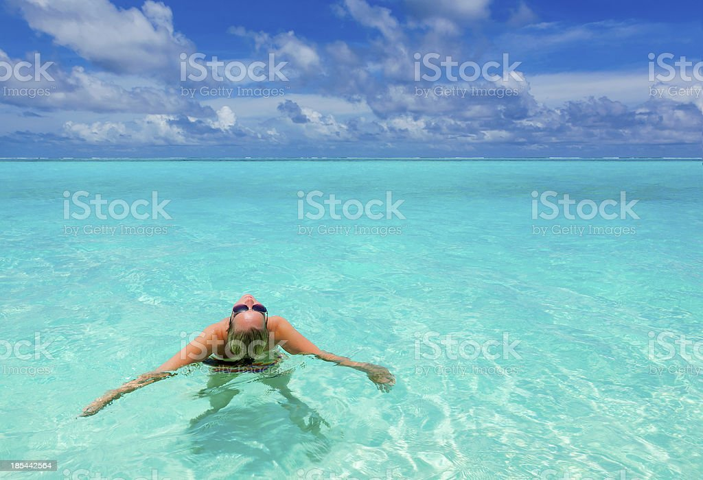 girl in the turquoise sea royalty-free stock photo