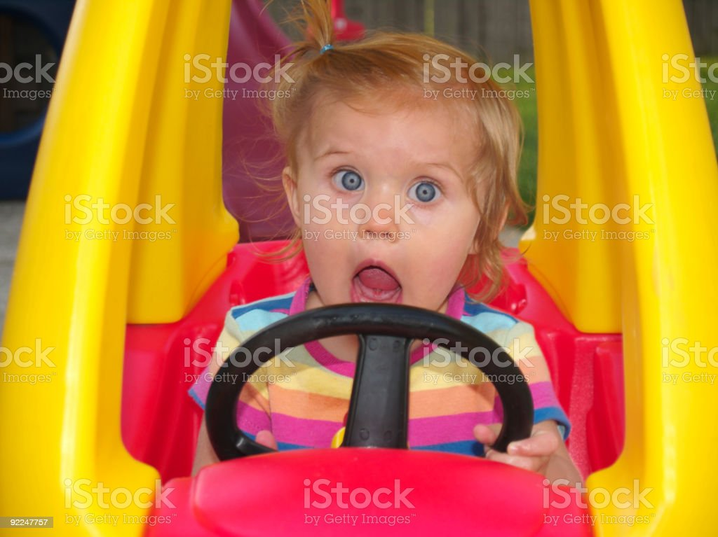 Girl in Toy Car royalty-free stock photo