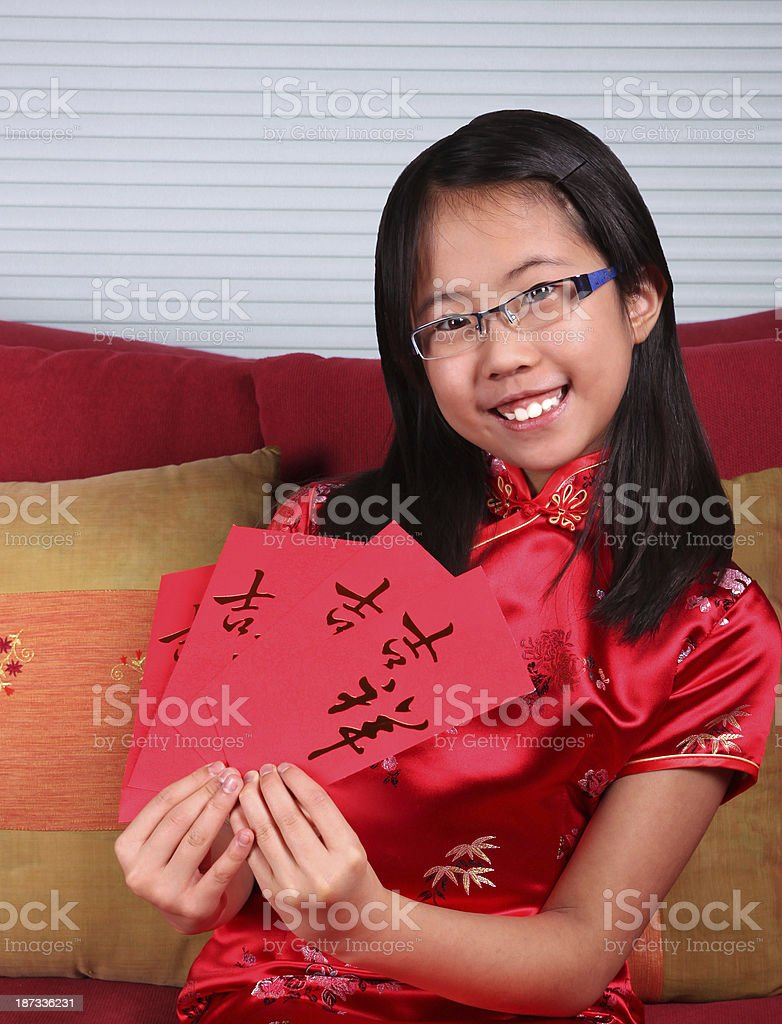 Girl in Traditional Dress Celebrates Chinese New Year stock photo