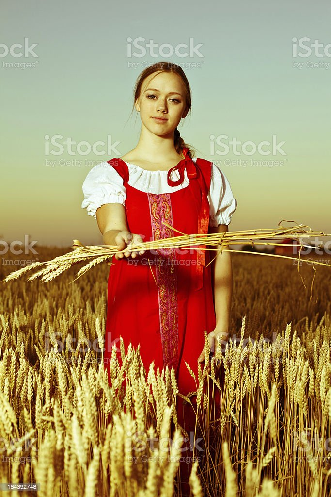 Girl in traditional Russian costume at wheat field. royalty-free stock photo