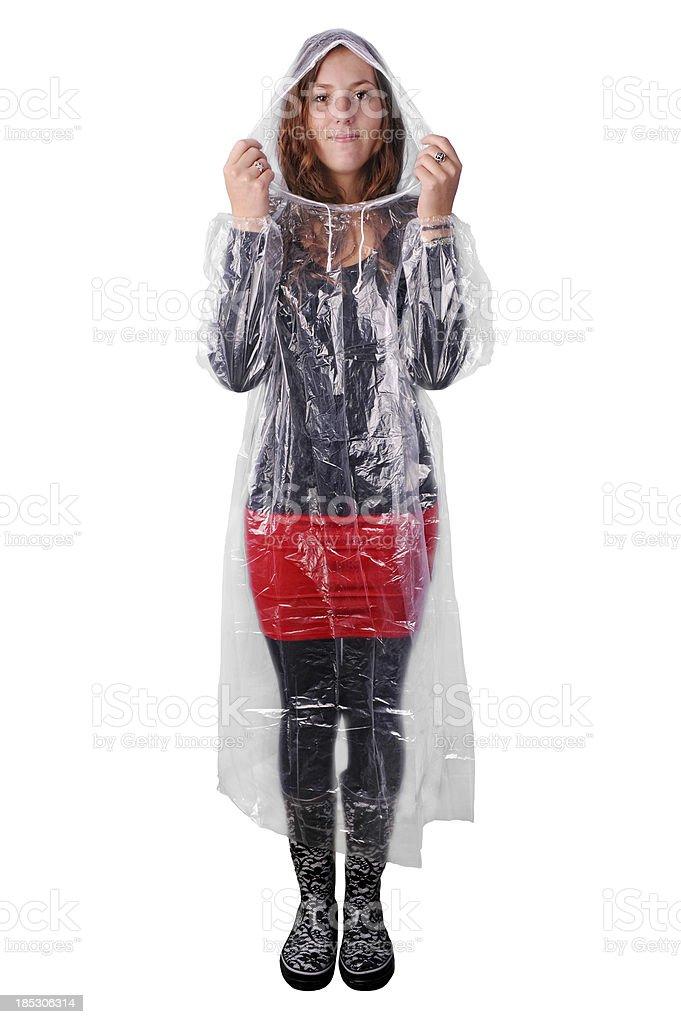 Girl in translucent plastic rain coat isolated on white royalty-free stock photo