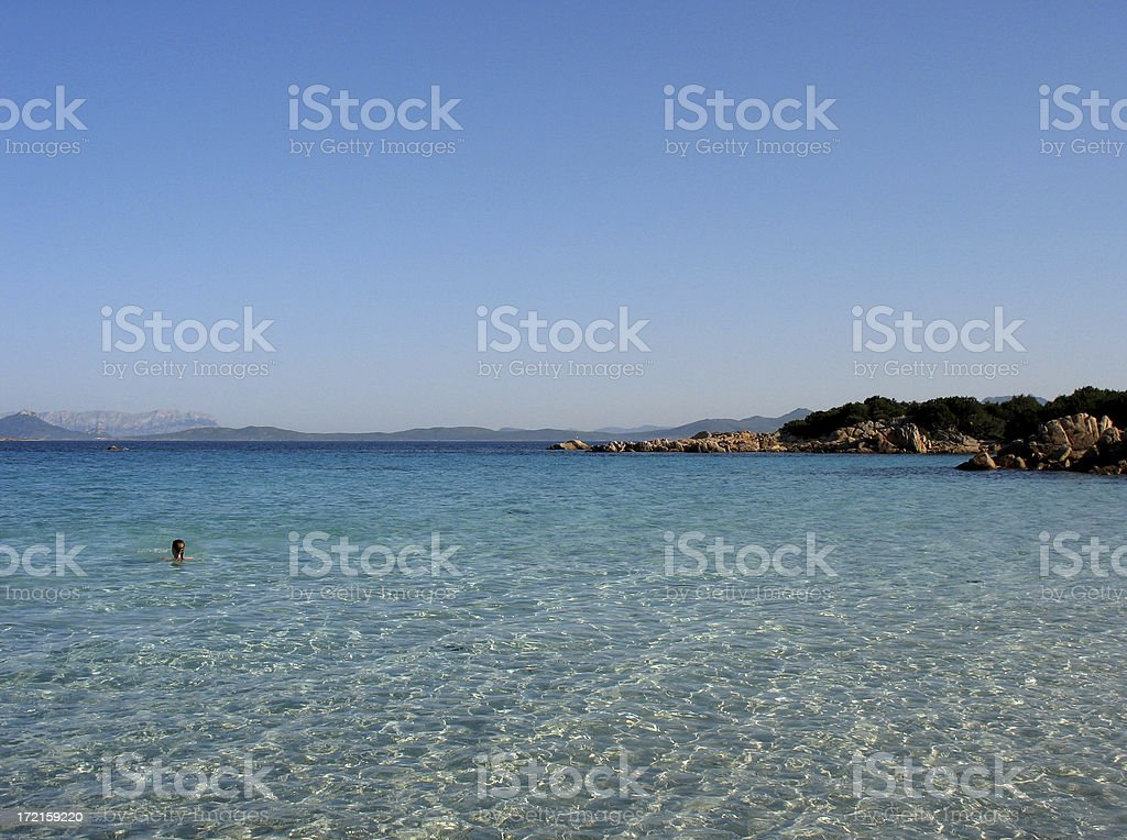Girl in turquoise water 2 stock photo