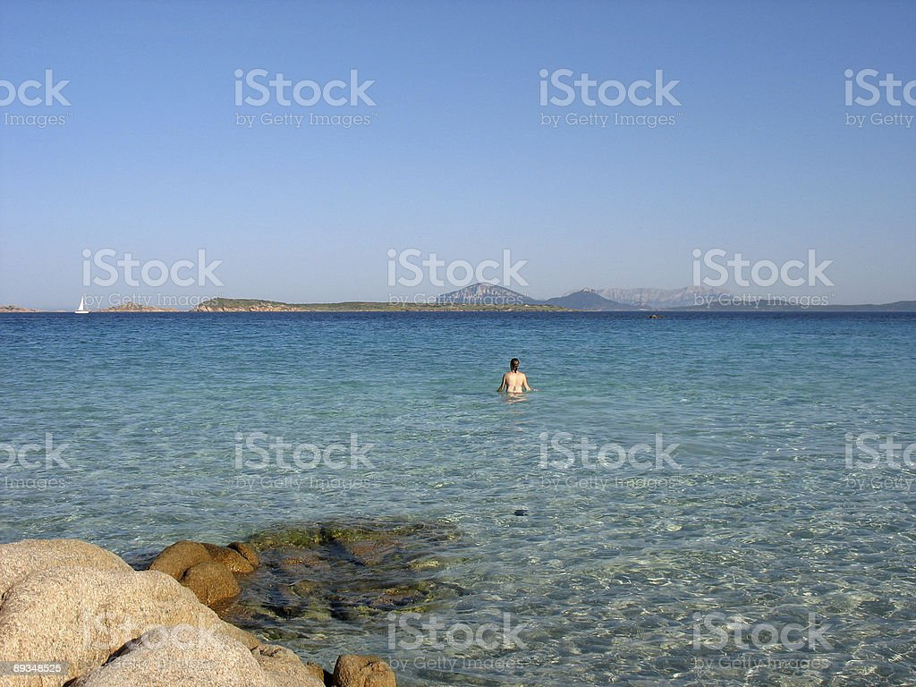 Girl in turquoise water stock photo
