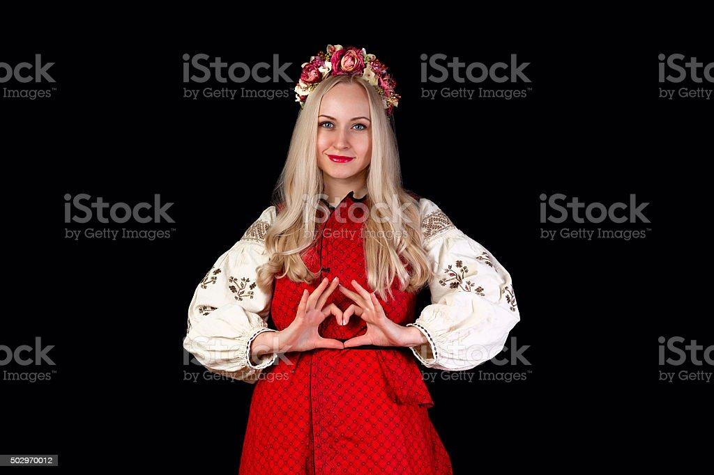 Girl in Ukrainian costume with love symbol stock photo