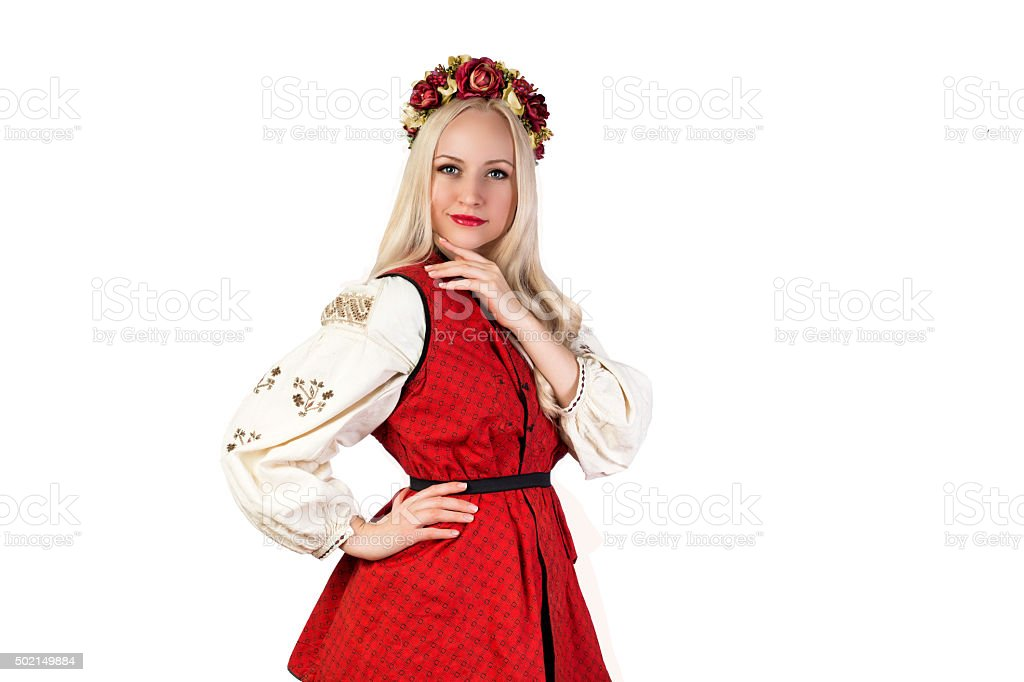 Girl in Ukrainian national traditional costume and chaplet stock photo