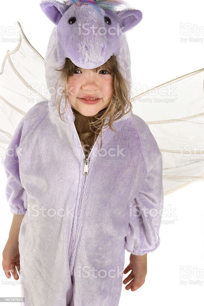 Girl in unicorn costume stock photo