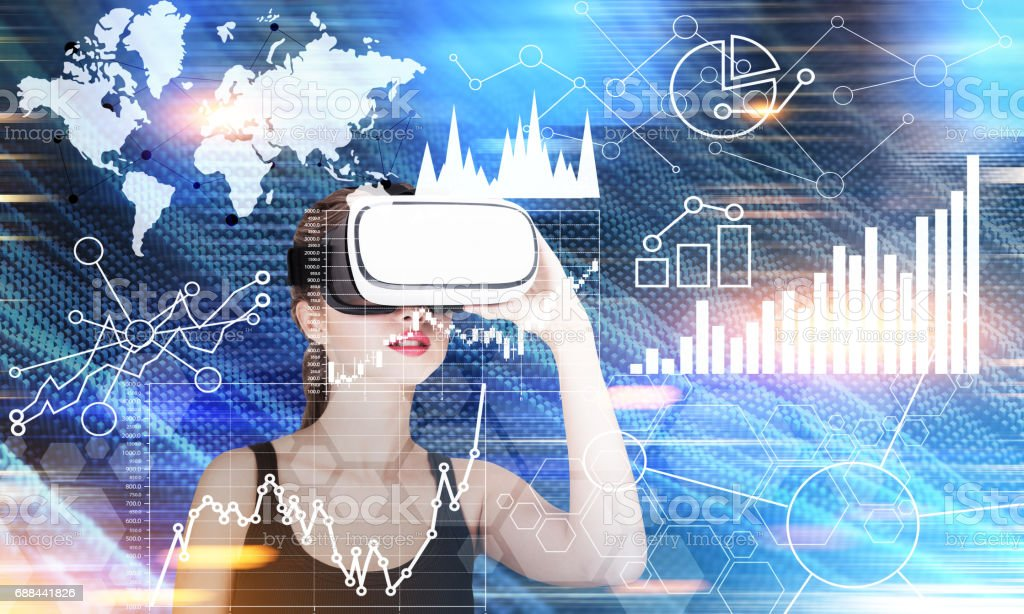 Girl in VR glasses and graphs in the air stock photo