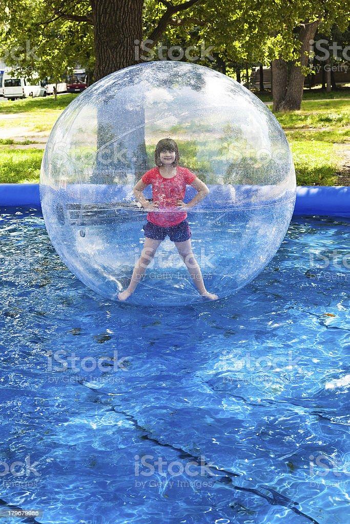 girl in water ball stock photo