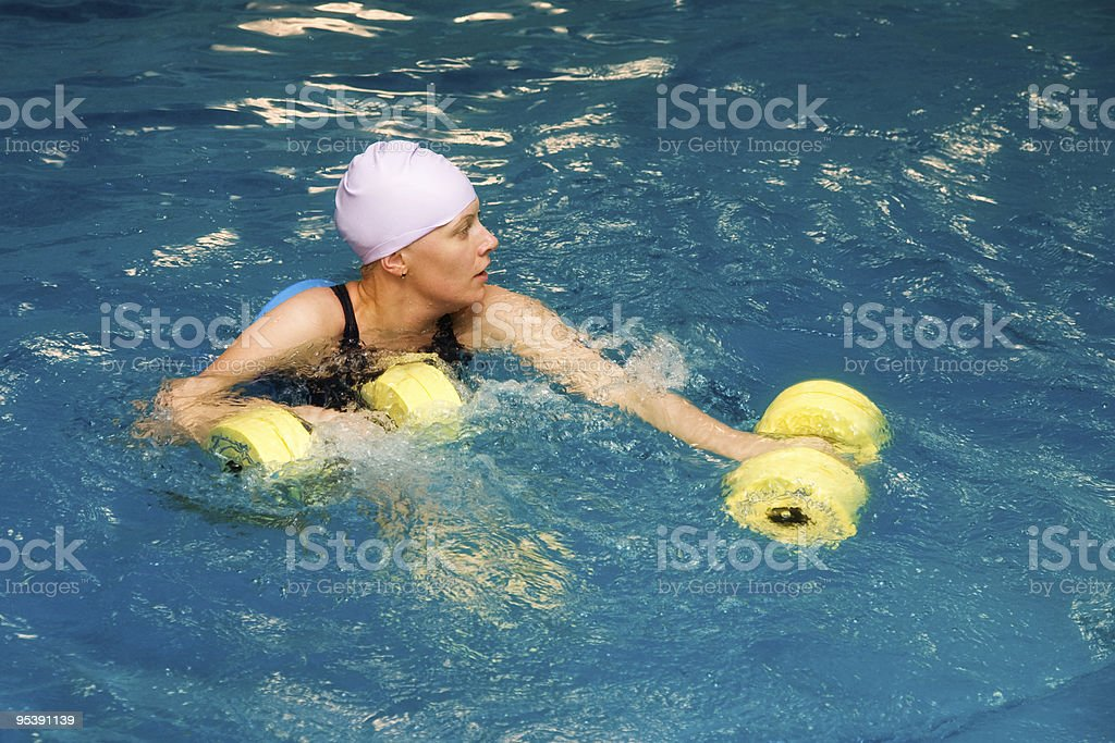 Girl in water with dumbbels royalty-free stock photo