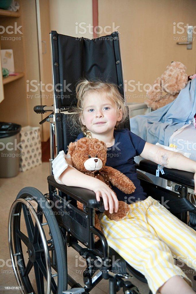 girl in wheelchair stock photo