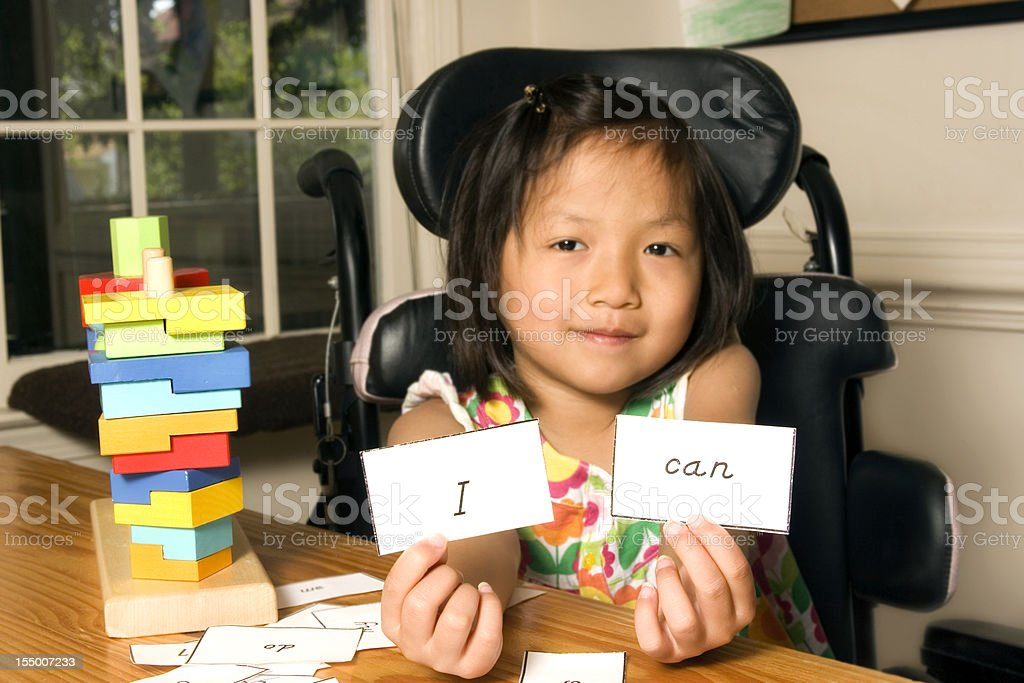 Girl in wheelchair with words of confidence stock photo
