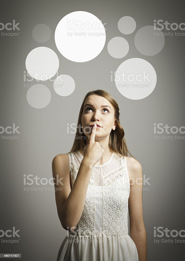 Girl in white and gray bubbles. stock photo
