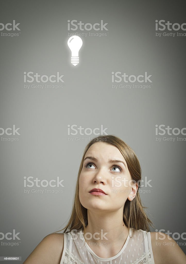 Girl in white and light bulb stock photo